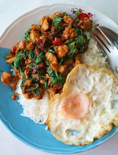 thai basil chicken in thai as pad kra pao gai